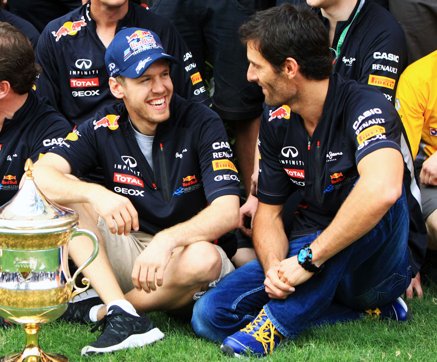 Sebastian Vettel enjoys a joke with his team-mate Mark Webber after winning the race