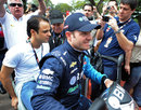 Felipe Massa hitches a ride with old friend Rubens Barrichello in the IndyCar paddock