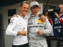 Michael Schumacher joins his brother Ralf in the DTM pitlane