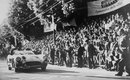 Stirling Moss crosses the line in Brescia to take victory at the Mille Miglia