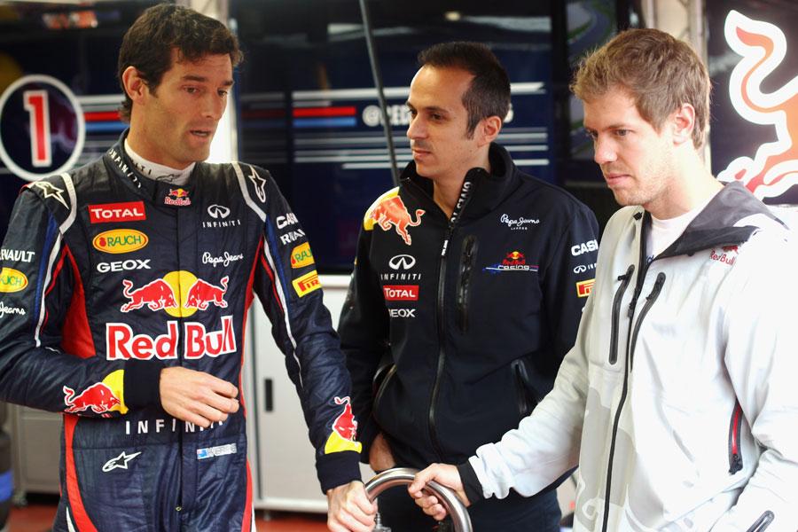 Mark Webber and Sebastian Vettel discuss the RB8 in the Red Bull garage