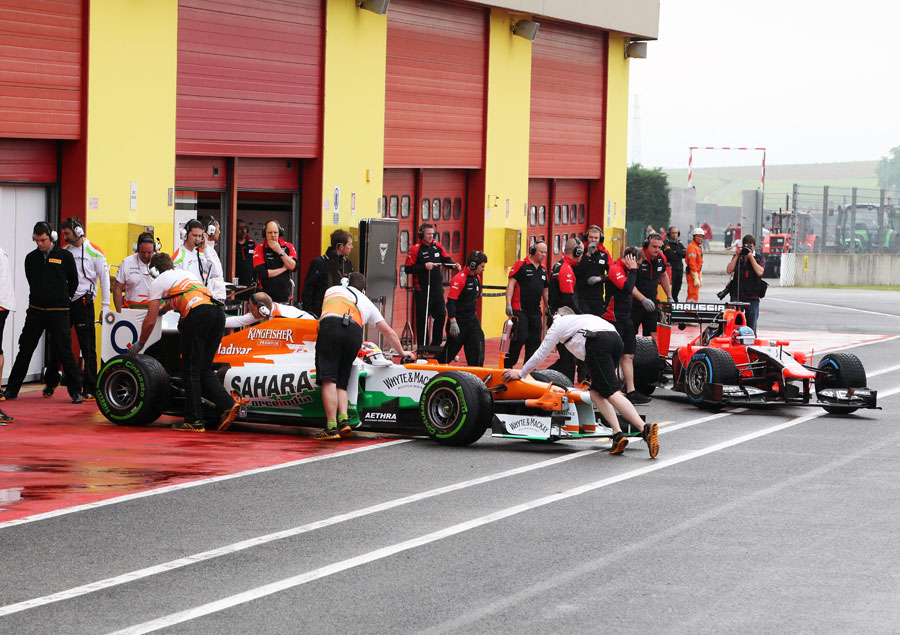 Jules Bianchi and Charles Pic return to the pits