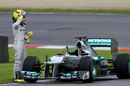 Nico Rosberg signals for help after stopping on track