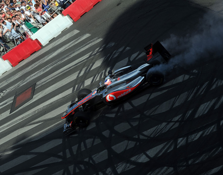 Jenson Button performs a burnout in front of Hungarian fans