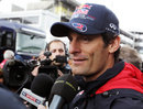Mark Webber talks to the press