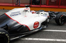 Kamui Kobayashi leaves the Sauber garage in the updated C31
