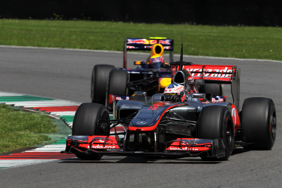 Mark Webber tracks down Gary Paffett's McLaren