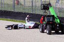 Kamui Kobayashi causes a red flag after beaching his Sauber in the gravel