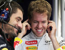 Sebastian Vettel shares a joke with his race engineer Guillaume Rocquelin