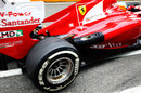 Fernando Alonso leaves the garage in the updated Ferrari