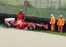 Fernando Alonso's updated Ferrari in the barriers after an accident in the morning
