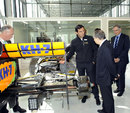 Pedro de la Rosa shows FIA president Jean Todt around the race bays at HRT's new base