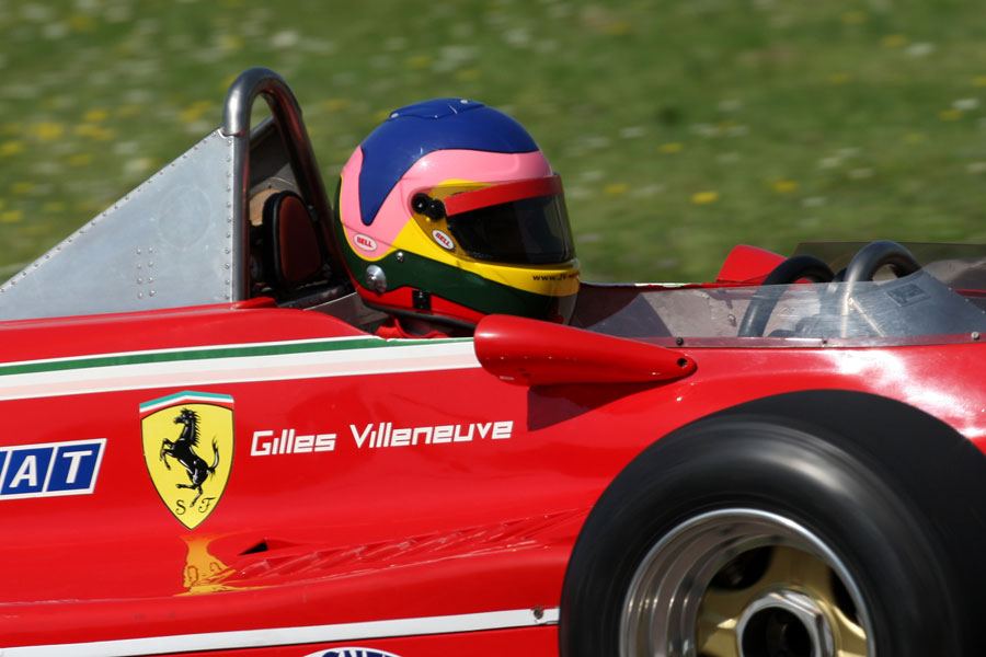 The distinctive helmet of Jacques Villeneuve in the 312 T4 that his father Gilles used to drive