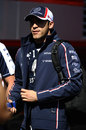 Pastor Maldonado walks through the paddock on Thursday