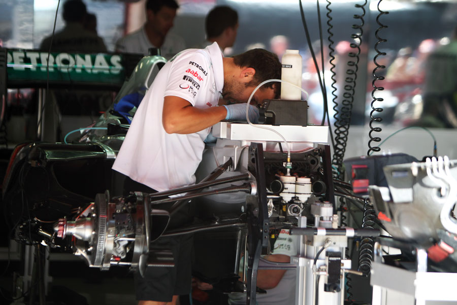 A Mercedes mechanic at work in the garage