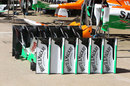Force India front wings neatly stacked in the pit lane