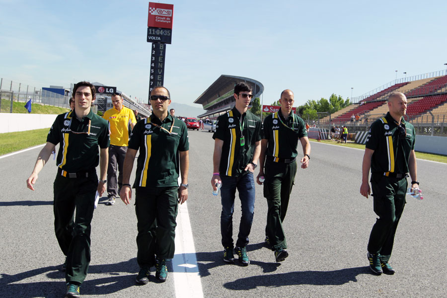 Alexander Rossi walks the track with his Caterham engineers ahead of his FP1 debut this weekend