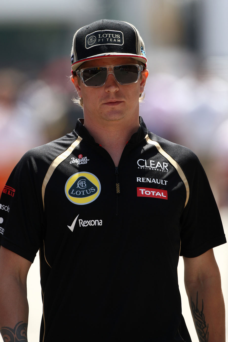 Kimi Raikkonen enjoys the sunshine in the paddock