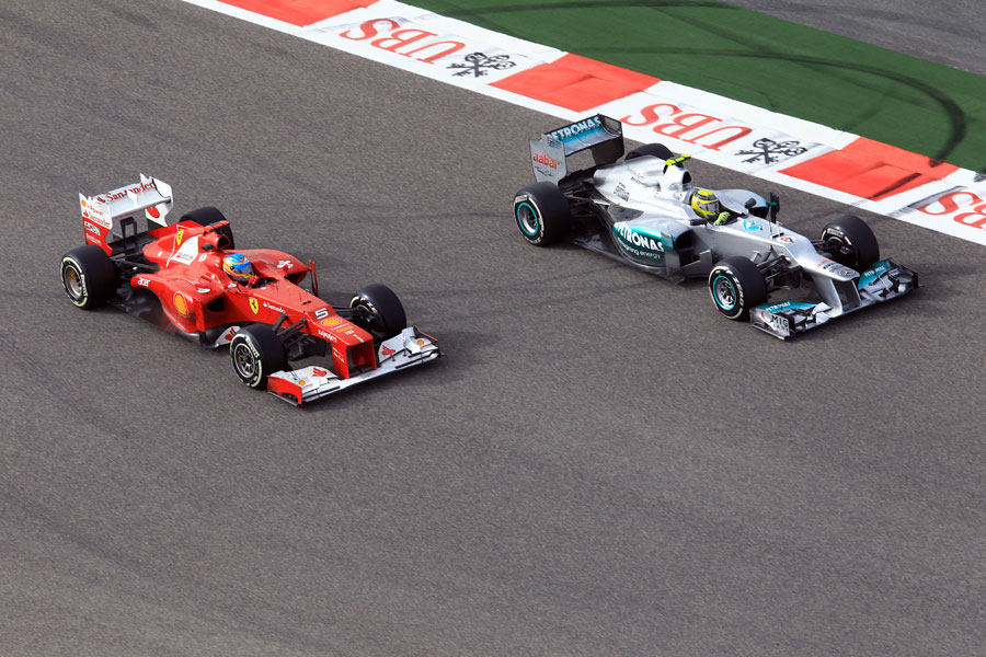 Fernando Alonso and Nico Rosberg battle for position