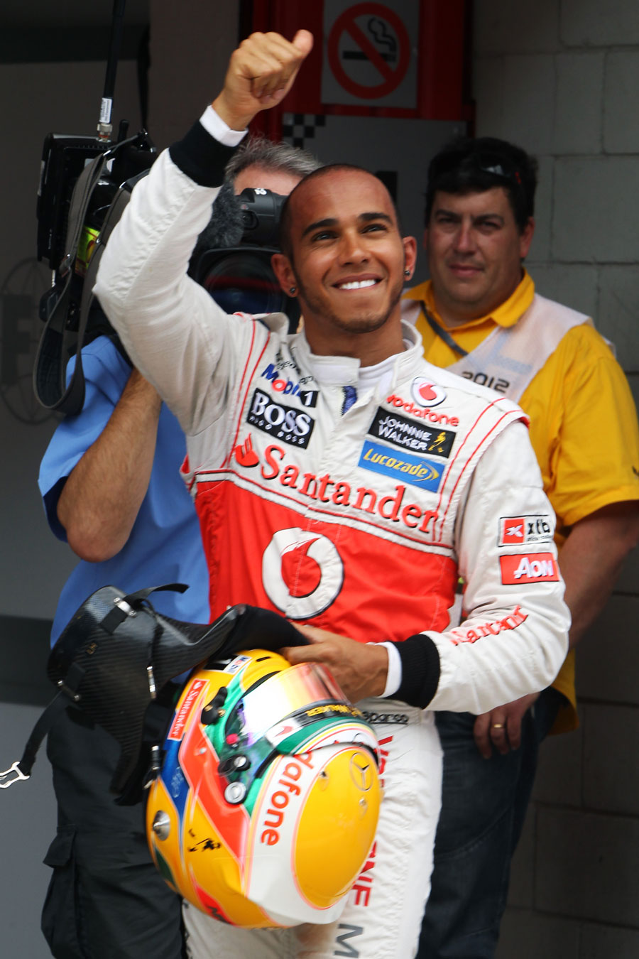 Lewis Hamilton waves to the fans after taking pole position