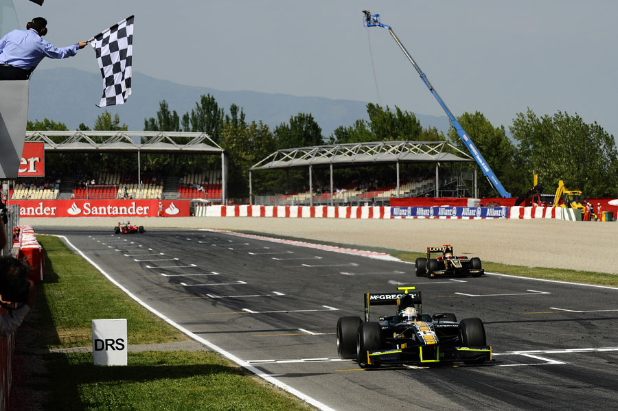 Giedo van der Garde takes the chequered flag ahead of James Calado and Stefano Coletti