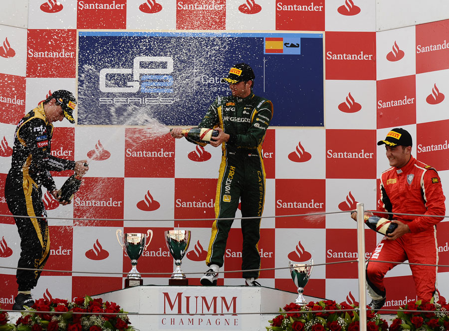 Giedo van der Garde celebrates on the podium with James Calado and Stefano Coletti