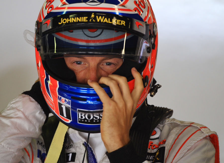 Jenson Button gets ready for qualifying