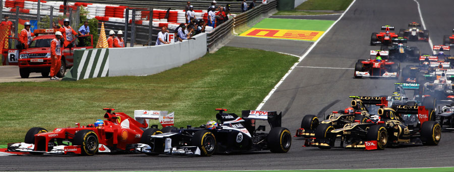 Fernando Alonso and Pastor Maldonado side by side into the first bend