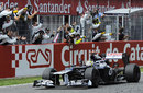 Pastor Maldonado crosses the line for his maiden win