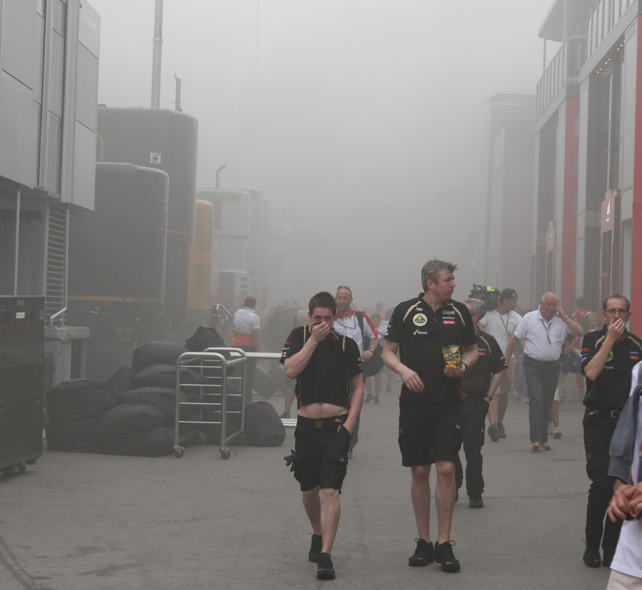 The pit lane is evacuated after a fire in the Williams garage