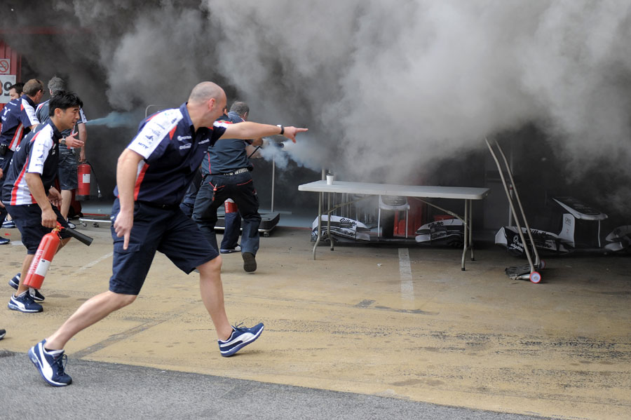 Mechanics tackle the blaze in the Williams garage