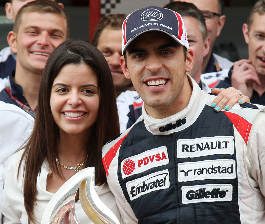 Pastor Maldonado celebrates with his girlfriend Gabriella Tarkany