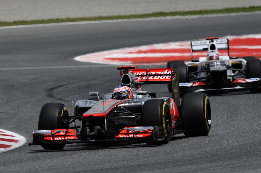 Jenson Button holds off Kamui Kobayashi
