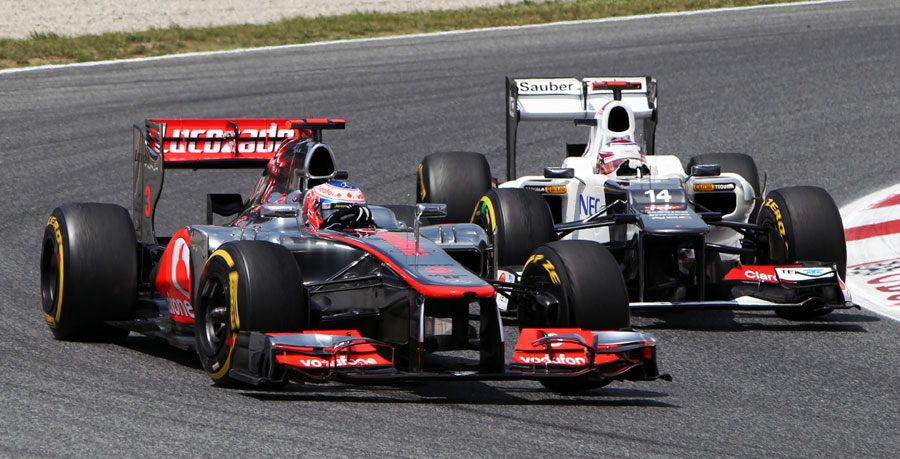 Kamui Kobayashi looks for a way up the inside of Jenson Button