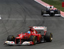 Fernando Alonso leads Pastor Maldonado early in the race