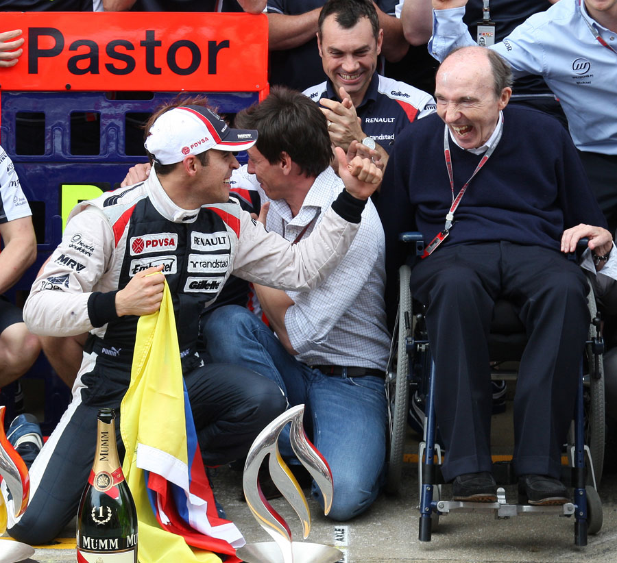 Pastor Maldonado celebrates his maiden win with a delighted Sir Frank Williams