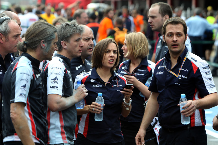 Concerned Williams team members in the pit lane