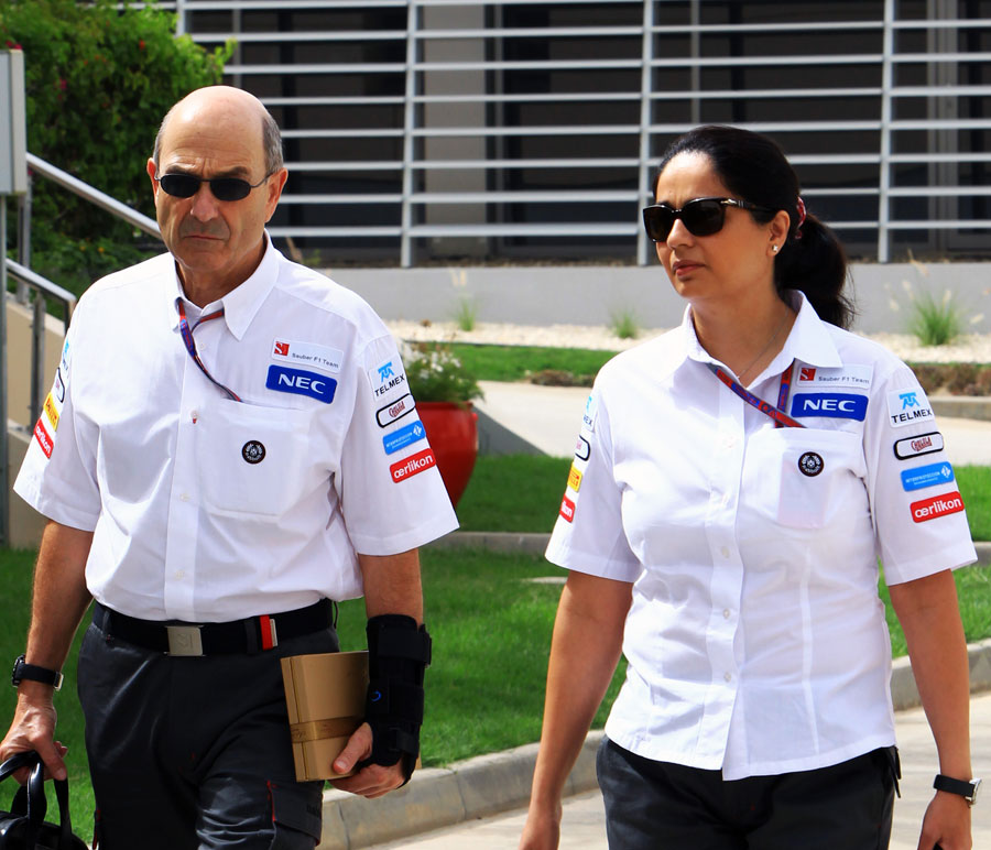 Peter Sauber and Monisha Kaltenborn walk through the paddock