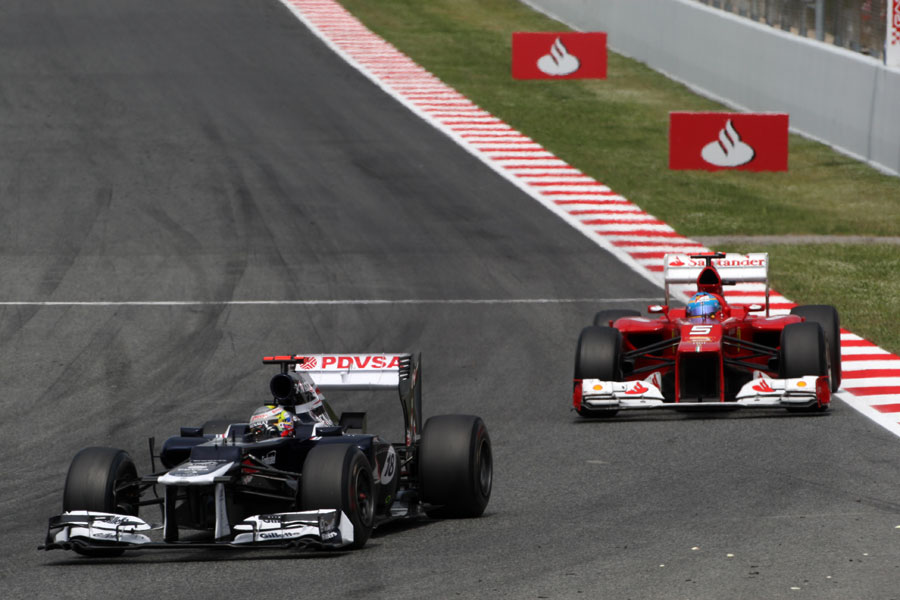 Pastor Maldonado leads Fernando Alonso in the closing laps