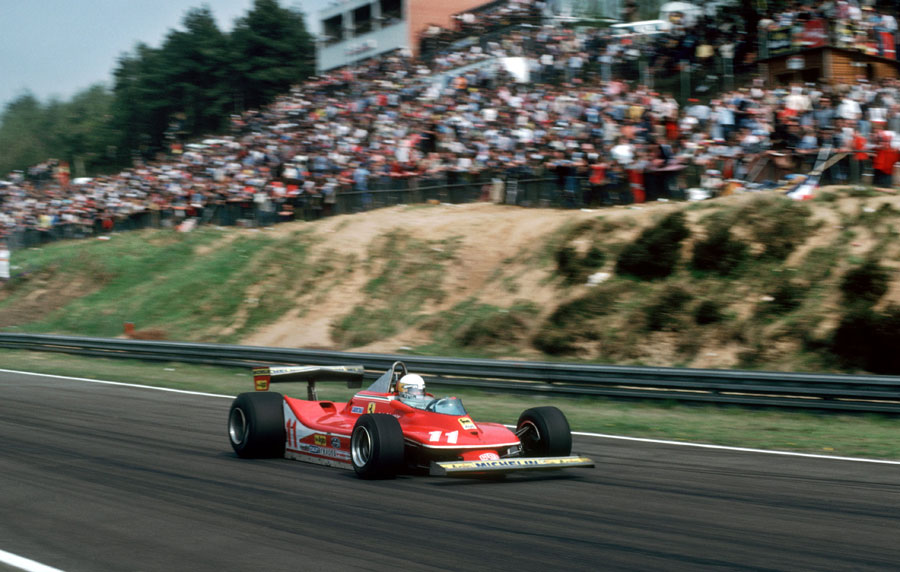 Jody Scheckter speeds past the thousands of fans on his way to victory