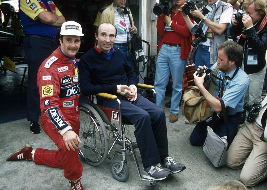Nigel Mansell poses for a photo with Frank Williams on his return to the paddock following the accident that paralysed him from the chest down