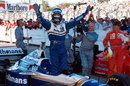 Damon Hill celebrates sealing the title