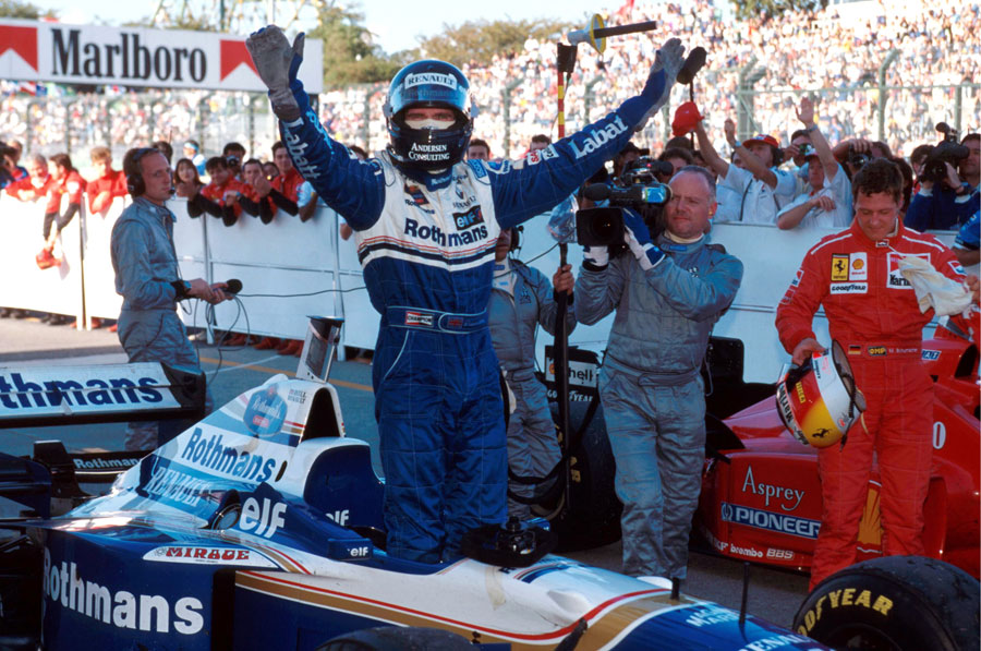 Damon Hill celebrates sealing the title