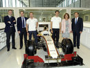 HRT officials, drivers Pedro de la Rosa and Dani Clos and the mayoress of Madrid pose for a photo in the team's new factory