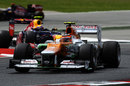 Nico Hulkenberg leads Mark Webber out of the chicane