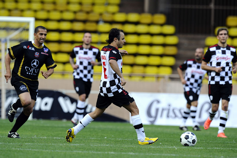 Felipe Massa looks for a pass during a drivers' charity football match