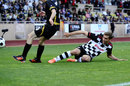 Vitaly Petrov slides in to make a tackle that can't end well