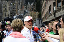 Michael Schumacher speaks to the press in the paddock
