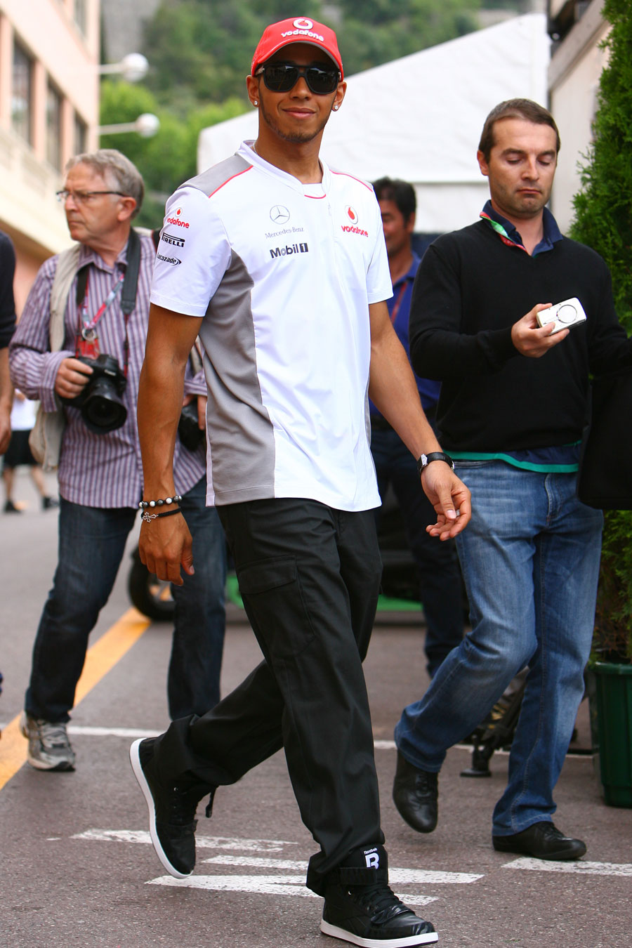 Lewis Hamilton walks through the Monte Carlo paddock