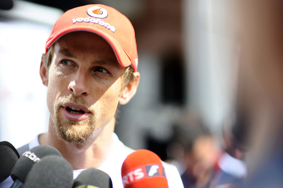 Jenson Button talks to the press on Wednesday